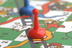 Snakes & Ladders. A single piece in a game of Snakes & Ladders Stock Image