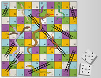 Snakes and ladders board game. Snakes and ladders is an ancient Indian board game. Its regarded today as a worldwide classic Royalty Free Stock Image