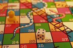 Snakes and Ladders board game stock photo