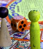 Snakes and ladders with giant nut Royalty Free Stock Photo