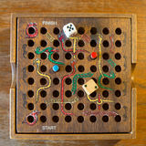 Snakes and Ladders. Wooden game on a wooden floor/table stock photos