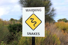 Snakes warning sign in bushland Stock Photo