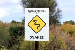 Snakes warning sign in bushland Stock Photo