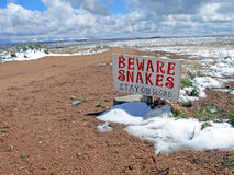 Snakes warning sign, winter mountains landscape, Royalty Free Stock Image