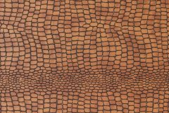 Snakeskin. Artificial snakeskin background in detail Stock Images