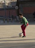 Snap portrait of a foot ball playing boy. A boy is playing football on ground for fun stock photo