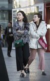 Snap portrait of  girls. Two fashion girls are going to shopping Royalty Free Stock Photography
