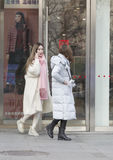 Snap portrait of  girls. Two fashion girls are shopping Royalty Free Stock Photo