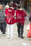 Snap portrait of travelers. Two mothers in Chinese minority clothes is carrying babies sightseeing in China Royalty Free Stock Photos