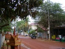 Cambodia small town on a rainy day. Snap shot Cambodian small town on a rainy day looking road stock photos