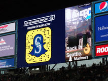 Snapchat ad on screen in bleachers at Safeco Field Stock Images