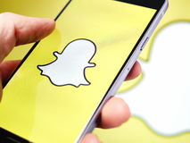 Snapchat application. Snapchat app logo displayed on a smartphone Stock Image