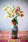 Snapdragon flowers in a vase on the table royalty free stock photography