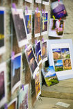 Snaphots of moments printed pinned to the walls in a multitude of colors Stock Photos