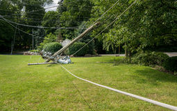 Snapped and downed power post and line after storm stock images