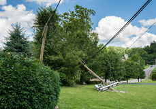 Snapped and downed power post and line after storm stock photos