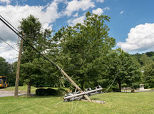 Snapped and downed power post and line after storm Royalty Free Stock Photos
