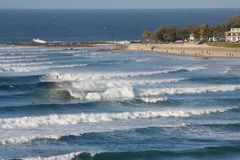 Snapper Rocks and with surfers, Coolangatta, Australia stock photo
