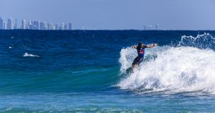 Unidentified Surfer races the Quiksilver & Roxy Pro World Title Event. SNAPPER ROCKS, GOLD COAST, AUSTRALIA - 9 MARCH: Unidentified Surfer races the Royalty Free Stock Image