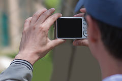 Snapshot. Man holding a point and shoot digital camera Stock Photos