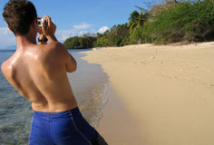 Snapshot. Taking digital photographs of beach in the philippines royalty free stock photo