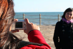 Snapshot. One girl taking a picture of another Stock Photos