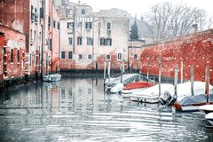 Snapshot of the houses and the parked boats by the canal,in a venice neighboorhood. Venice / Italy 19 february 2019 :Snapshot of the houses and the parked boats stock photos