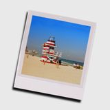 Snapshot of lifeguard station. Colorful lifeguard station depicted in Polaroid frame royalty free stock photo