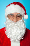 Snapshot of smiling senior man in Santa attire Stock Images