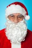 Snapshot of smiling senior man in Santa attire Stock Images