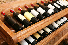 Snapshot of the wine cellar. The bottles on wooden shelves Royalty Free Stock Images