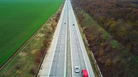 Cars and trucks running on the highway. Snapshots of aerial shot from drones. Trucks and cars are moving on the highway at high speed. Images drawn along the stock video footage