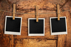 Snapshots hanging on wooden board Stock Images