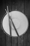Snare Drum. With well worn stick resting on top. Photographed from above in back and white with wood planks as a background Royalty Free Stock Photos