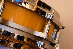 Snare Drum. A wooden piccolo snare drum against a solid background Royalty Free Stock Image