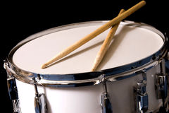 Snare Drum and Drum Sticks. Against black background Stock Photo