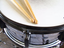 Snare Drum and Drumsticks. Drumsticks resting on the head of a snare drum Stock Photography