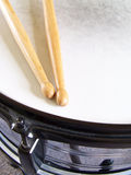 Snare Drum and Drumsticks. Drumsticks resting on the head of a snare drum Royalty Free Stock Photo