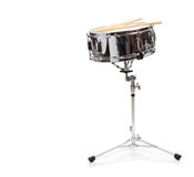 A snare drum on a white background. A snare drum with drumsticks on a white background Royalty Free Stock Images