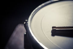 Snare drum and a pair of drum sticks. A snare drum and a pair of drumsticks royalty free stock photography