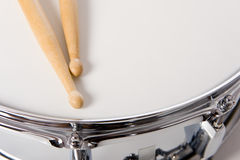 Snare Drum Set with Sticks. A new silver snare drum with sticks on a white background Stock Photography