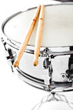 Snare & drumsticks. A studio photo of a snare drum & two drumsticks Stock Photos