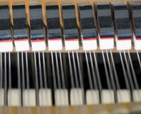Snares mutes and hammers inside a grand piano. Abstract look into the inside of a bechstein grand piano Royalty Free Stock Image