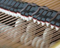 Snares mutes and hammers inside a grand piano. Abstract look into the inside of a bechstein grand piano Stock Image
