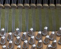 Snares pins and mutes inside old bechstein grand piano. Closeup of snares pins and mutes inside old bechstein grand piano Royalty Free Stock Photography