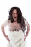 Snarling uncouth long haired caveman Royalty Free Stock Photography