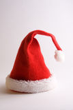 Snata claus hat. Hat of santa claus on white bottom Stock Image