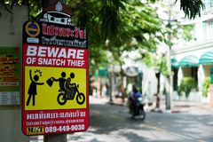 Snatch Thief warning sign Royalty Free Stock Images