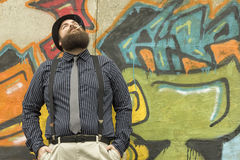 Snazzy Bearded Man. Smokes a cigarette on a city street Royalty Free Stock Images