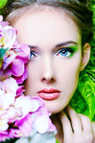 Snazzy look. Portrait of a beautiful girl with flowers. Spring Royalty Free Stock Photos